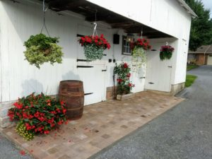 Barn forebay with hanging baskets and pots